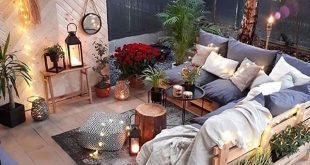 this outdoor living room with it's custom pallet furniture and boho styling ...